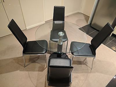 Dining table (glass, round) and 4 dining chairs