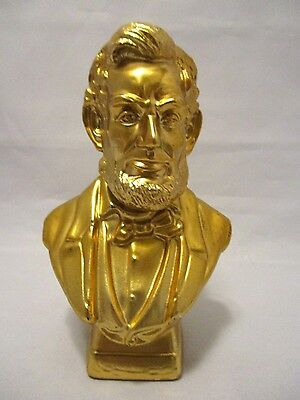 COLLECTIBLE VINTAGE AVON BOTTLE Bust of ABRAHAM LINCOLN Gold Color 1979 Empty