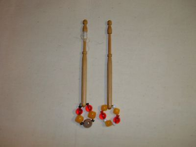 A pair of wooden lace bobbins