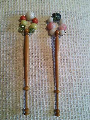 A pair of wooden lace bobbins with spangles