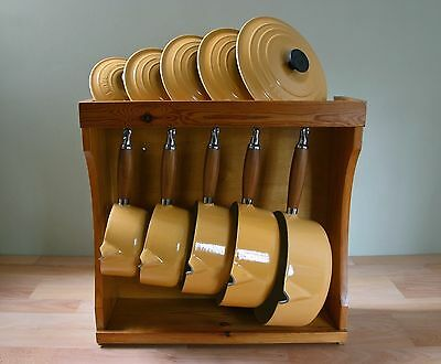 Set Of Five Le Creuset Yellow Cast Iron Saucepans With Lids Wooden Display Rack
