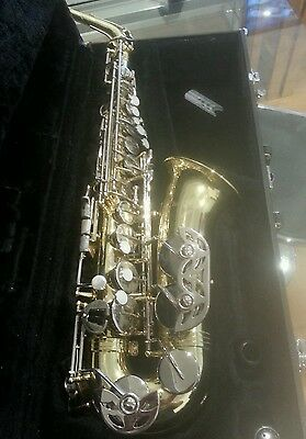 Alto saxophone with stands