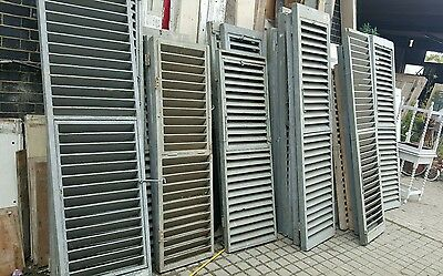 Salvaged Pairs of Wooden Shutters
