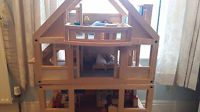 Large wooden doll's house.