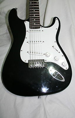 A  Black  6 strings Electric Guitar by Stagg ( Fender )