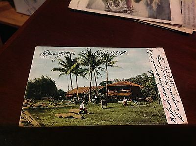 Antique postcard with rare ink stamp depecting a burmese village