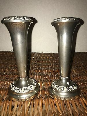 A pair of silver-plated posy vases