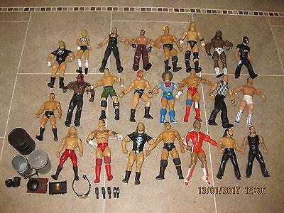 Large bundle of vintage 23 x WWE figures and accessories