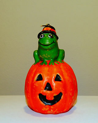 Halloween Frog Witch on a Jack O Lantern Pumpkin Candle