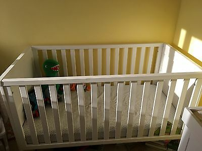 white cot bed with mattress