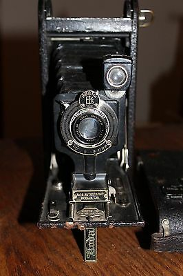 Kodak1A folding Autographic pocket camera with leather case and instructions