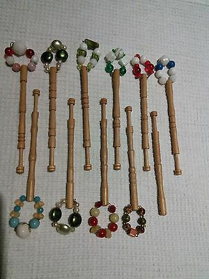 11 Lace Bobbins in polished light wood with spangles