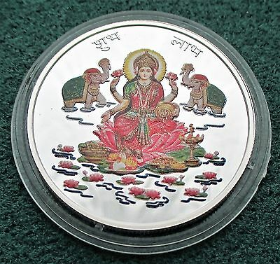 A SOLID SILVER Goddess Lakshmi silver enamelled coin by Valcambi of Switzerland