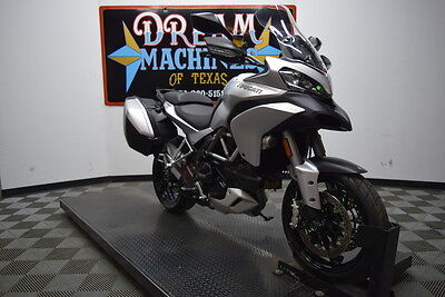 Ducati Multistrada  2014 Ducati Multistrada 1200 S Touring ABS $14,985 Book Value* We Finance