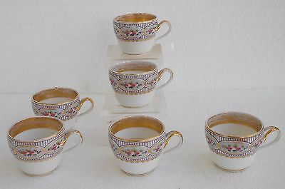 Six tasses porcelaine de Paris XIXème peint main