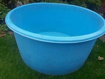 Large blue round plastic pond / holding tank