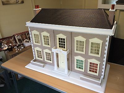 Large dolls house, fully furnished. Plus  boxed spare furniture.