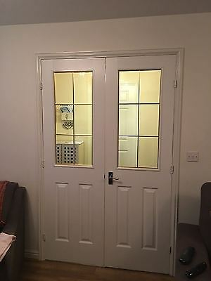 Pair of White Wooden Internal Doors with glass panel and silver handles