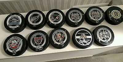 Lot  of 11Signed Official NHL Game Pucks