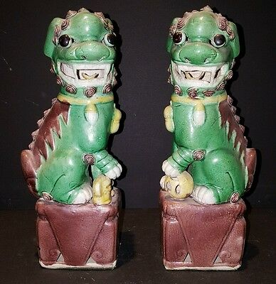 chinese export green Foo Dogs on brown base with ball and dog
