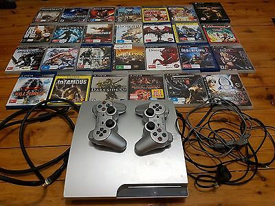 Playstation 3 with 2 controllers and 27 games