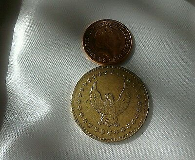 I don't know what this is? United states eagle brass coin.?