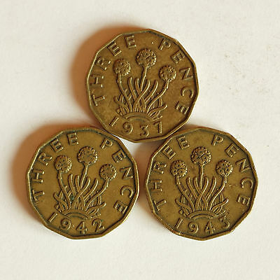Three George VI brass THREE-PENCE coins dated 1937, 1942 & 1943