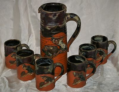 SUMIDA GAWA TANKARD & 6 CUPS signed JAPANESE or KOREAN POTTERY with FIGURES