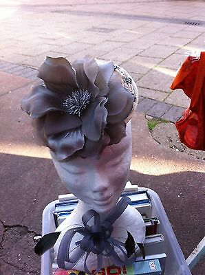 Lovely fascinator with fabric flower & sequins