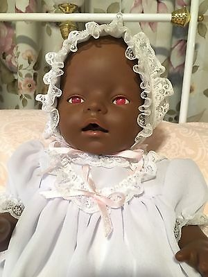 Black Baby Born with Pink Eyes in Beautiful Outfit.