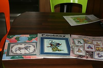 Fantasy cross stitch booklets - wizards, faeries, carousel horse