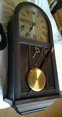 Antique chiming wall clock from conservative club.