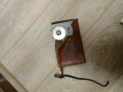 Astor Transistor - red colour in brown case