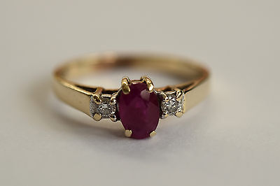 Fine 9ct gold diamond and ruby three stone engagement ring