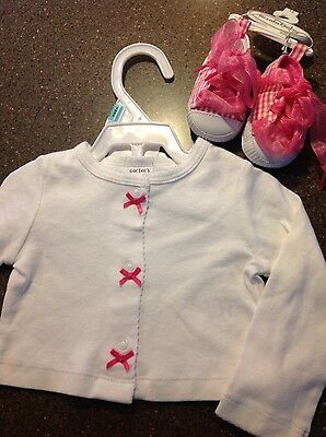 Baby's White sweater size 6 months and pink shoes size 0