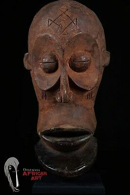 Chokwe Cihongo Male Mask with Red Oxide Exterior on Custom Stand