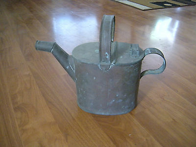 Vintage can watering spout can