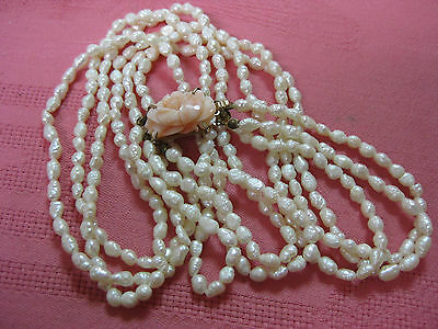 "Fine 3/4"" carved angel skin coral clasp w/25"" triple strand freshwater pearls"