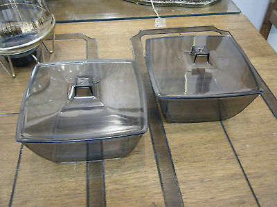 Pair of two mid century black smoked acrylic covered serving bowls