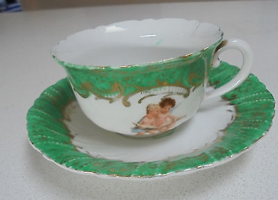 Vintage Green tea cup saucer with CHERUB DESIGN Tea Cup with Cherubs