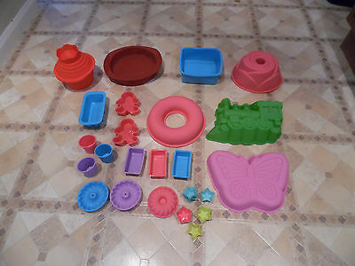 A Selection of  31 Silicone Baking Moulds New & Used