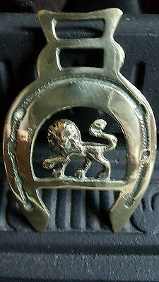 vintage horse brass good condition depicting a standing lion within a horseshoe