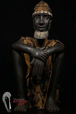 Discover African Art Sitting Dogon Hunter Statue with Huntress Tunic and Hat