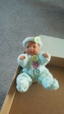 Mini baby born doll in hand knitted outfit
