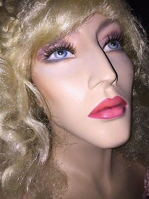 vintage female mannequin with blonde wig