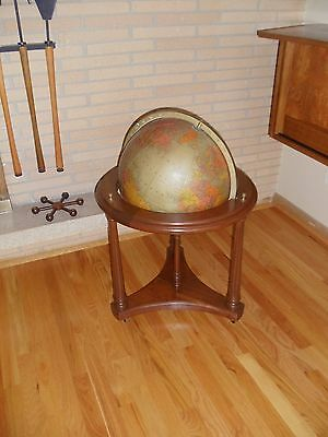 Elegant Mid century Replogle world globe on wheeled walnut stand vintage