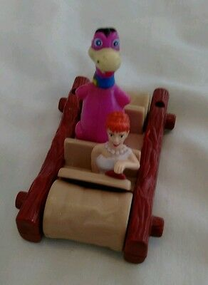 Flintstones car with Wilma and Dino.