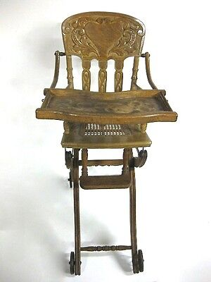 Antique Oak High Chair w/ caned seat *stamped 1904* converts to low stroller