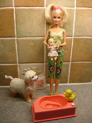 A Stunning Barbie Doll with Vintage Baby Doll, Dog and Bath with Accessories