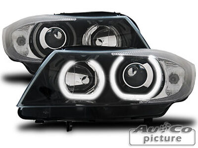 Coppia Fari Fanali anteriori con 2 anelli Angel Eyes LED per BMW E90 / E91